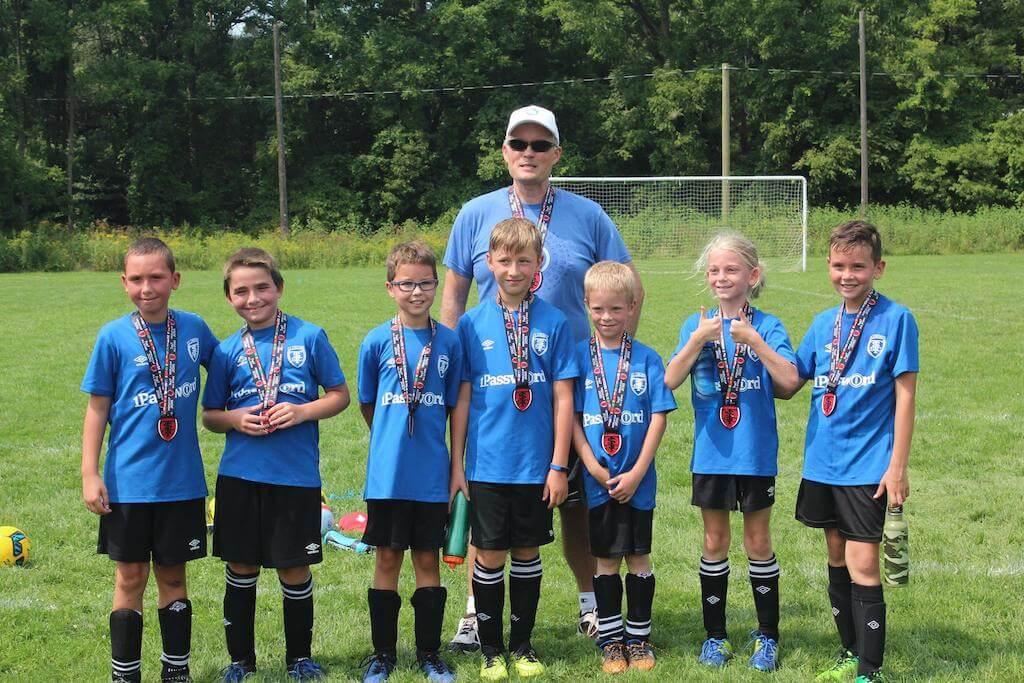 Coach Dave Teare with St Thomas Soccer Club