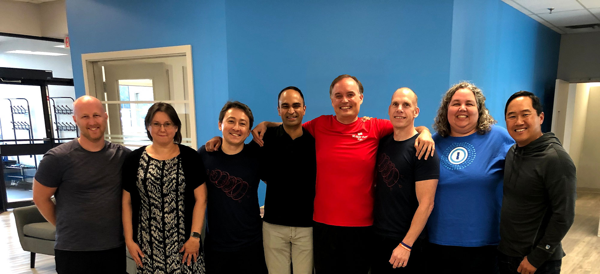 Group hug after sealing the deal in our St. Thomas, Ontario office. From left to right: Dan Levine, Natalia Karimova, Roustem Karimov, Arun Mathew, Dave Teare, Jeff Shiner, Sara Teare, Rich Wong.