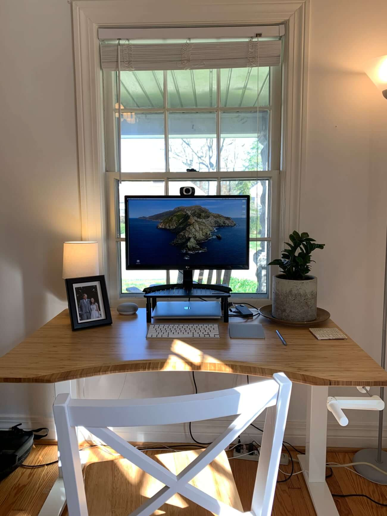 Image of Chris's desk in front of a large window